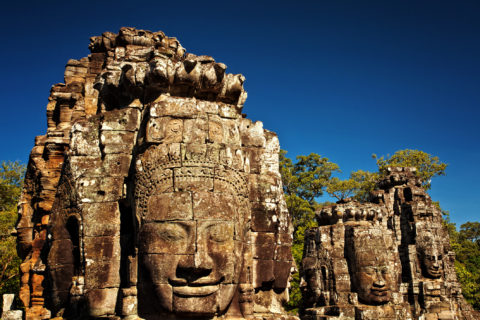 Faces Bayon Temple with a blue sky, Angkor Thom, Angkor Wat, Cambodia, Southeast Asia